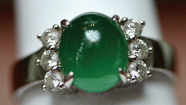 Cabochons of various shapes, bangle bracelets, and round or carved beads are the most common jadeite jewelry styles. The deep, even, green color of this cabochon is far from common, however. - Gift of Sophie Leu
